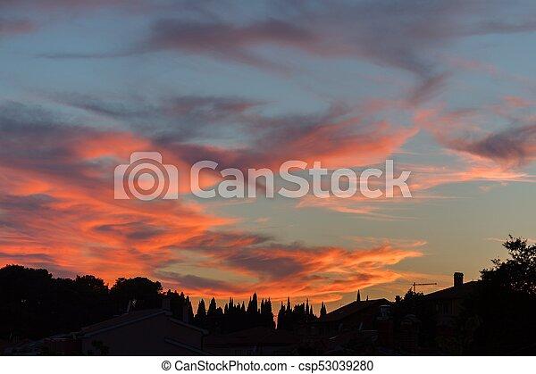 Beautiful sunset over dramatic sky - csp53039280