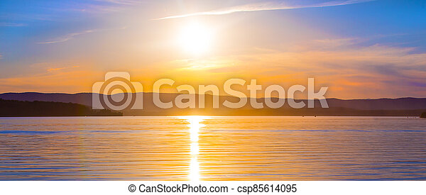 Beautiful sunset over the lake on a summer - csp85614095