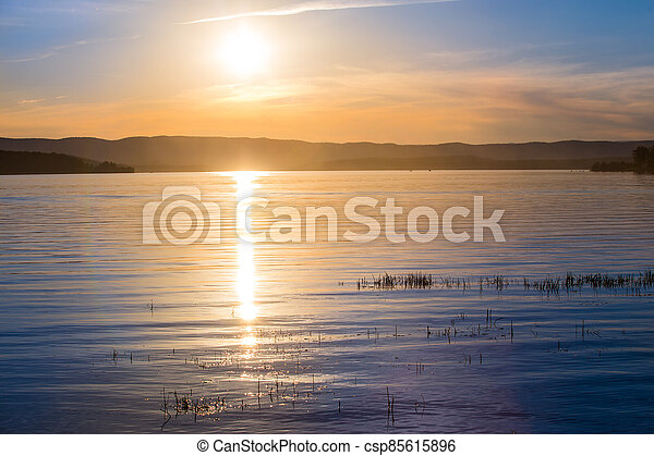 Beautiful sunset over the lake on a summer - csp85615896
