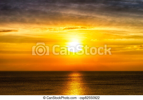 Beautiful sunset over the ocean - csp82550922