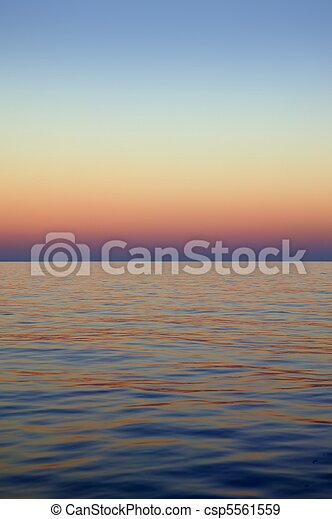 Beautiful sunset sunrise over blue sea ocean red  sky - csp5561559