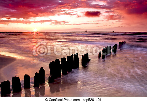 Beautiful sunset with breakwater. - csp5261101
