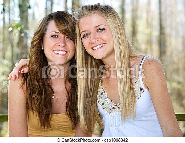 Beautiful Teen Sisters in Woods - csp1008342