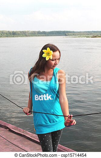 beautiful teenage girl on the bank of the river - csp15714454