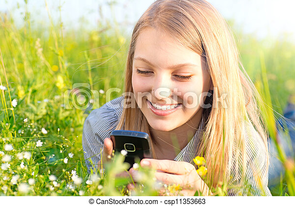 Beautiful Teenage Girl With Cellphone outdoors - csp11353663