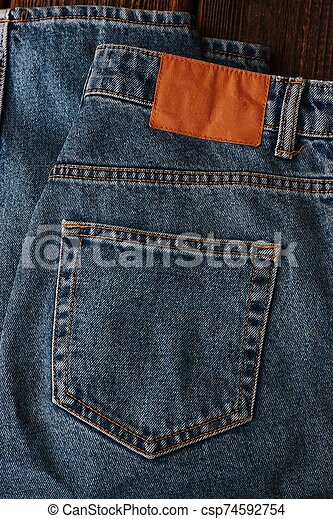 Beautiful textile blue jeans with pocket close up - csp74592754