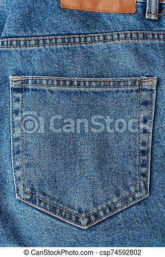 Beautiful textile blue jeans with pocket close up - csp74592802