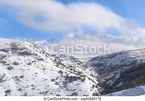 beautiful Tien-Shan mountains in the snow. in winter - csp52669179