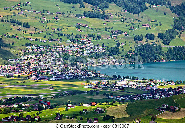 Beautiful town in a valley of the Alps in Switzerland - csp10813007