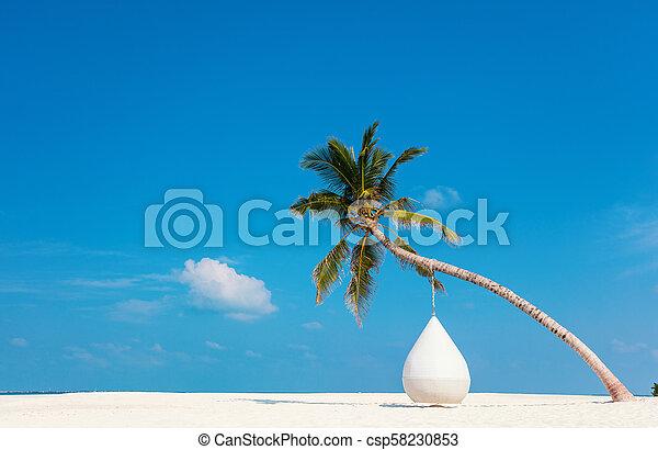 Beautiful tropical beach at Maldives - csp58230853