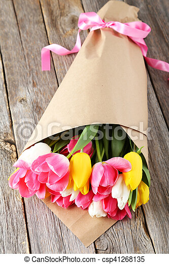 Beautiful tulips on grey wooden background - csp41268135