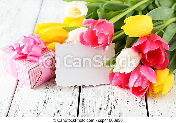 Beautiful tulips on white wooden background - csp41068930