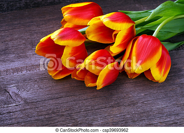 Beautiful tulips on wooden background - csp39693962