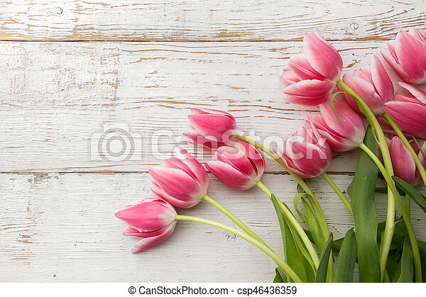 beautiful tulips on wooden background. - csp46436359