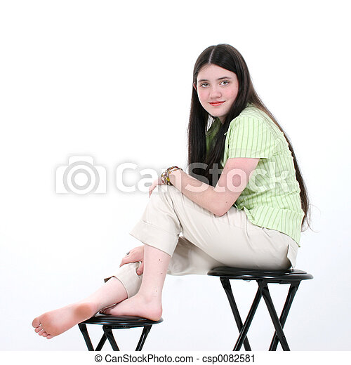 Beautiful Tween Girl Sitting On Stool - csp0082581