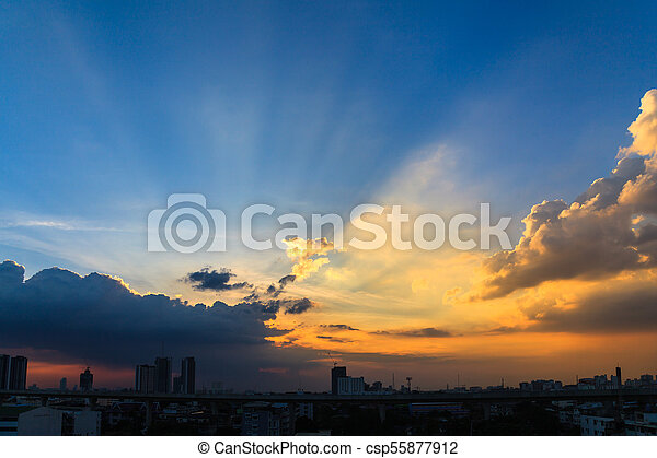 Beautiful twilight sky at sunset over a dark cityscape - csp55877912