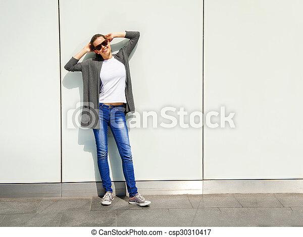 Beautiful urban woman, girl smiling in the city - csp30310417