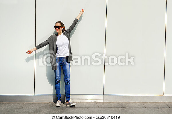 Beautiful urban woman, girl smiling in the city - csp30310419
