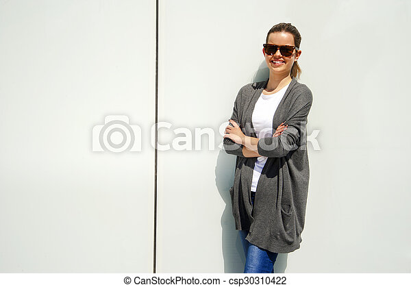 Beautiful urban woman, girl smiling in the city - csp30310422