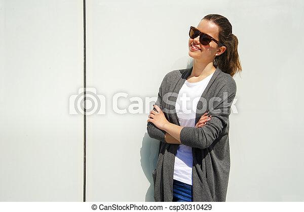 Beautiful urban woman, girl smiling in the city - csp30310429