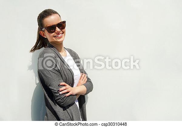 Beautiful urban woman, girl smiling in the city - csp30310448