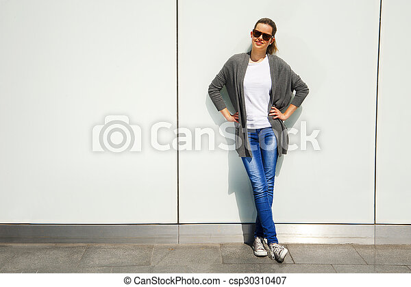Beautiful urban woman, girl smiling in the city - csp30310407