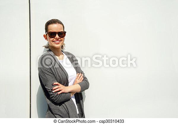Beautiful urban woman, girl smiling in the city - csp30310433
