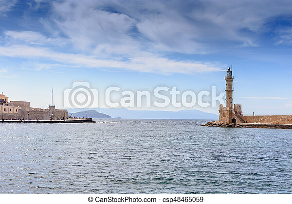 Beautiful view from shore to white lighthouse in port - csp48465059