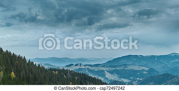 beautiful view of an autumn mountain landscape with a cloudy sky - csp72497242