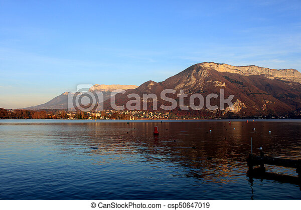 Beautiful view of the Annecy Lake in French Alps in sunset - csp50647019