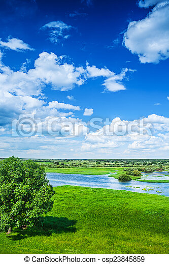 Beautiful view on flood field with blue cloudy sky in spring ins - csp23845859