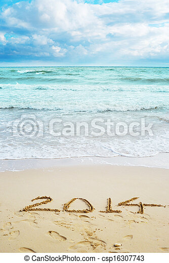 Beautiful view on the beach with 2014 year signs - csp16307743