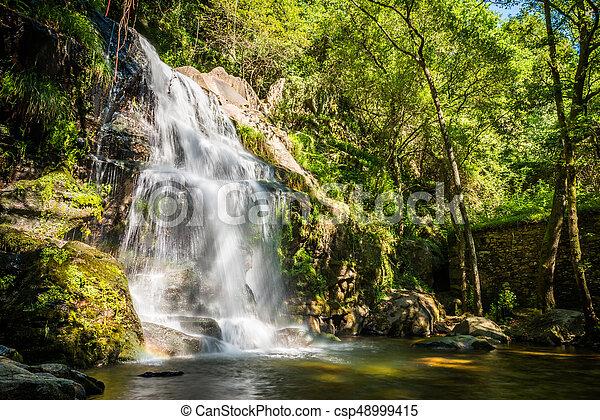 Beautiful waterfall in Cabreia Portugal - csp48999415