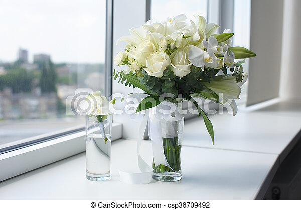 Beautiful Wedding Bouquet In A Glass Vase Flowers On White