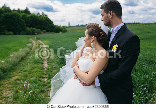 Beautiful wedding couple on nature - csp32890366