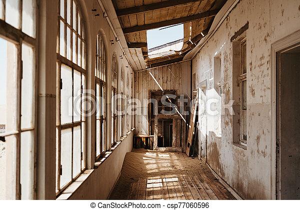 beautiful western villa with big windows and desert sand coverding the floor - csp77060596