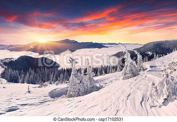 Beautiful winter sunset in the mountains - csp17102531