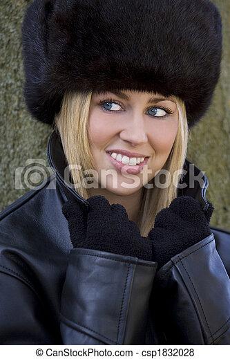 2e62086c3f16c Beautiful winter warmth. A beautiful young blond woman wearing a ...