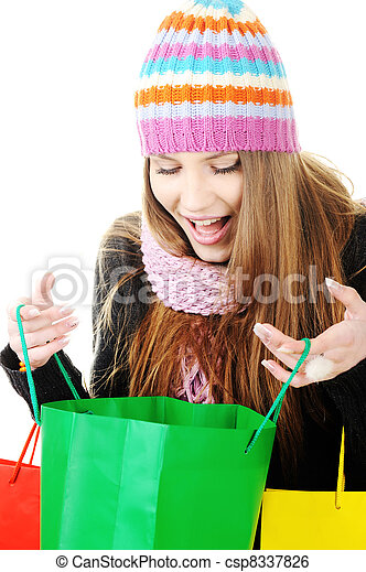 Beautiful winter woman with shopping bags - csp8337826
