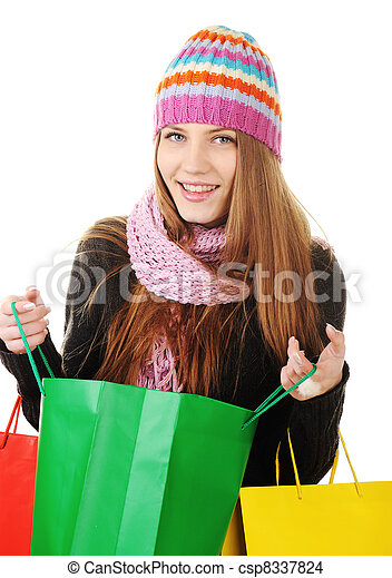 Beautiful winter woman with shopping bags - csp8337824