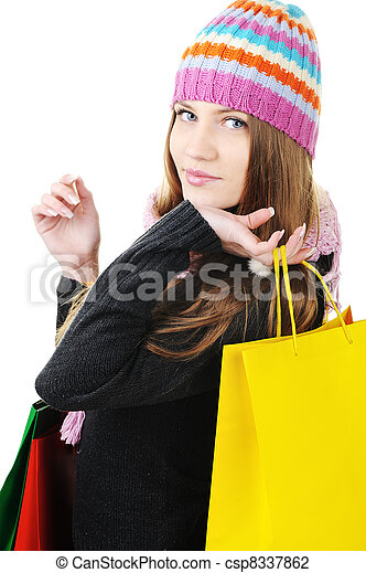 Beautiful winter woman with shopping bags - csp8337862