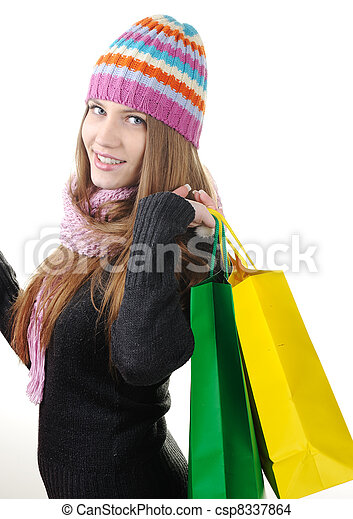 Beautiful winter woman with shopping bags - csp8337864