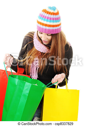 Beautiful winter woman with shopping bags - csp8337829