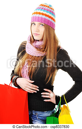 Beautiful winter woman with shopping bags - csp8337830