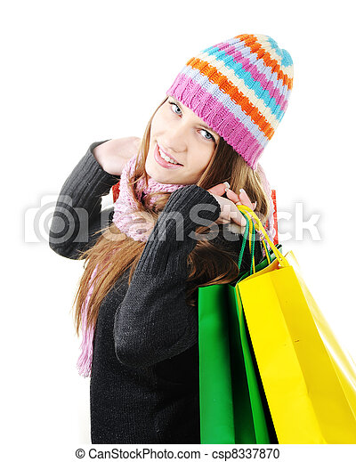 Beautiful winter woman with shopping bags - csp8337870