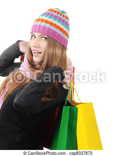 Beautiful winter woman with shopping bags - csp8337873