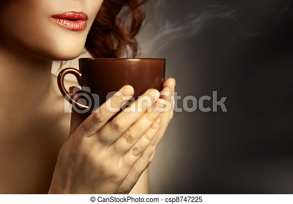 Beautiful Woman Drinking Coffee. Space for text  - csp8747225