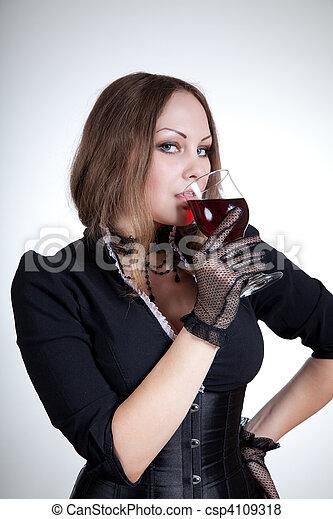 Beautiful woman drinking red wine    - csp4109318