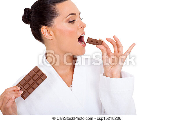beautiful woman eating chocolate - csp15218206