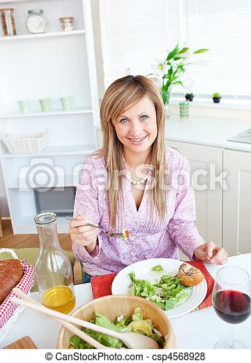Beautiful woman eating salad - csp4568928
